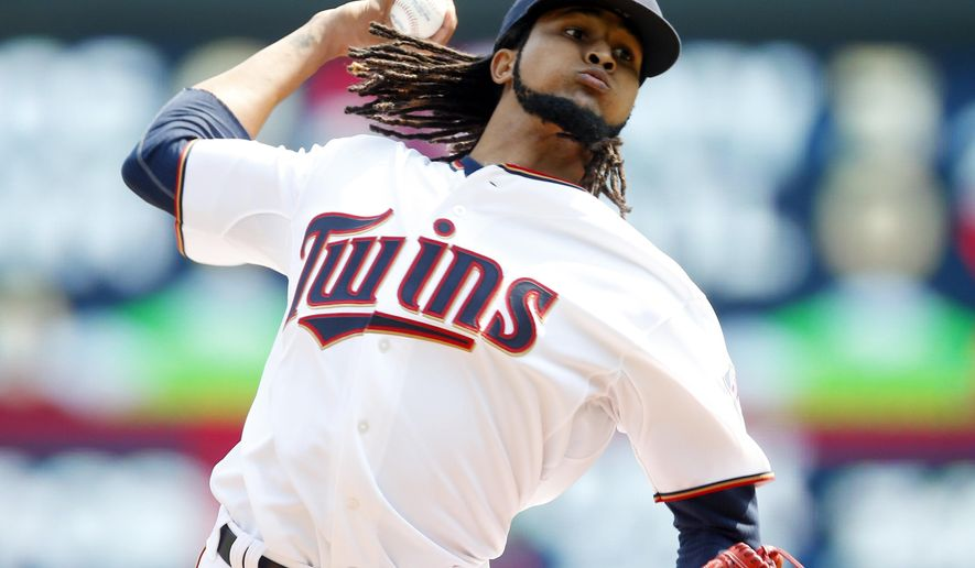 Minnesota Twins pitcher Ervin Santana throws against the Houston Astros in the first inning of a baseball game, Sunday, Aug. 30, 2015, in Minneapolis. (AP Photo/Jim Mone)