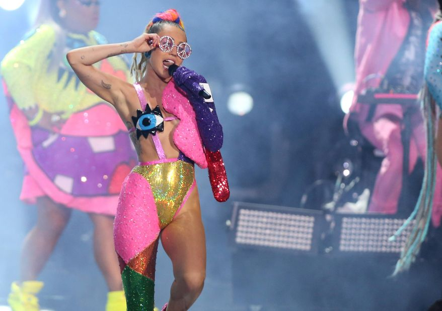 Miley Cyrus performs at the MTV Video Music Awards at the Microsoft Theater on Sunday, Aug. 30, 2015, in Los Angeles. (Photo by Matt Sayles/Invision/AP) ** FILE **