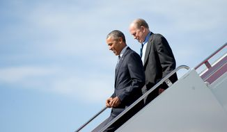 President Barack Obama, accompanied by Alaska Gov. Bill Walker, steps off Air Force One after arriving at Elmendorf Air Force Base, Monday, Aug. 31, 2015, in Anchorage, Alaska. President Barack Obama opens a historic three-day trip to Alaska aimed at showing solidarity with a state often overlooked by Washington, while using its glorious but changing landscape as an urgent call to action on climate change. (AP Photo/Andrew Harnik)