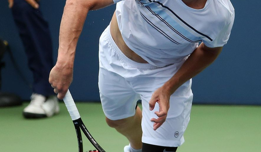 Mardy Fish serves to Marco Cecchinato, of Italy, during the first round of the U.S. Open tennis tournament, Monday, Aug. 31, 2015, in New York. (AP Photo/Adam Hunger)