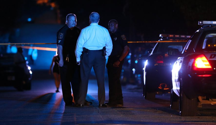 DeKalb County police officers work at the scene where an Atlanta-based officer was shot Monday evening, Aug. 31, 2015, five miles from Atlanta. DeKalb County police spokeswoman Mekka Parrish did not immediately have any details about the circumstances of the shooting. (Ben Gray/Atlanta Journal-Constitution via AP) MARIETTA DAILY OUT; GWINNETT DAILY POST OUT; LOCAL TELEVISION OUT; WXIA-TV OUT; WGCL-TV OUT; MANDATORY CREDIT