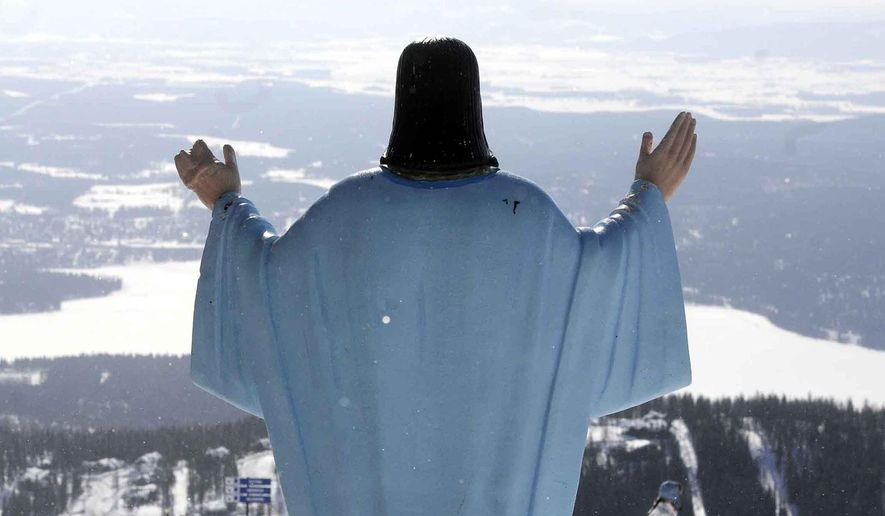 In this Feb. 20, 2011, file photo, the statue of Jesus Christ at Whitefish Mountain Resort overlooks Whitefish Lake and the Flathead Valley in Whitefish, Mont. (Linda Thompson/The Missoulian via AP) ** FILE **