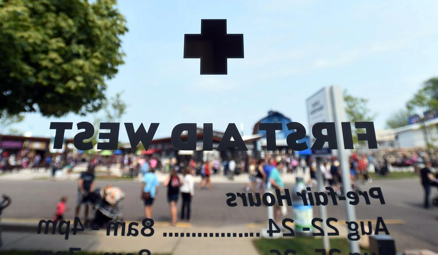 A view from inside the First Aid West at the Minnesota State Fair in Falcon Heights, Minn. is shown on Thursday, Aug. 27, 2015. Of the nearly 2 million people who will visit the Minnesota State Fair this year, a few thousand will wind up seeking help at first-aid stations. Of the nearly 2 million people who will visit the Minnesota State Fair this year, a few thousand will wind up seeking help at first-aid stations. The two first-aid stations on the Fairgrounds offer free health care from registered nurses, paramedics and emergency medical technicians.  (Holly Peterson/St. Paul Pioneer Press via AP)