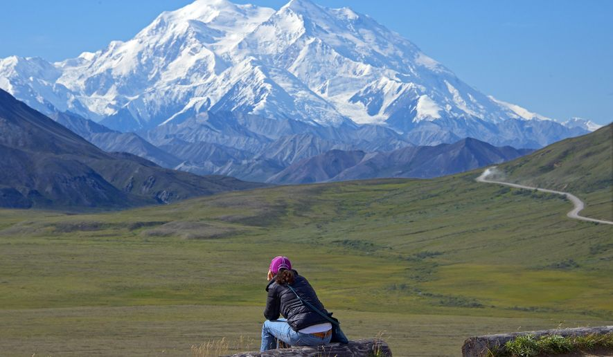 A woman gazes at Mount McKinley in Denali National Park and Preserve in Alaska. (Andy Newman/Holland America Line via AP)