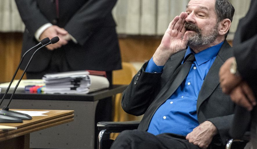 Frazier Glenn Miller yells as the jury as they leave after he was found guilty of one count of capital murder, three counts of attempted murder and assault and weapons charges on Monday, Aug. 31, 2015, in the Johnson County Courthouse in Olathe, Kan. (Allison Long/The Kansas City Star via AP, Pool)