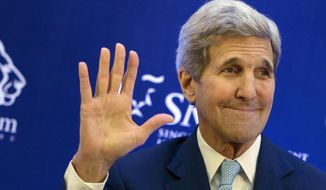 This Aug. 4, 2015, file photo shows U.S. Secretary of State John Kerry waving after delivering a speech at Singapore Management University in Singapore. (Brendan Smialowski/Pool Photo via AP)