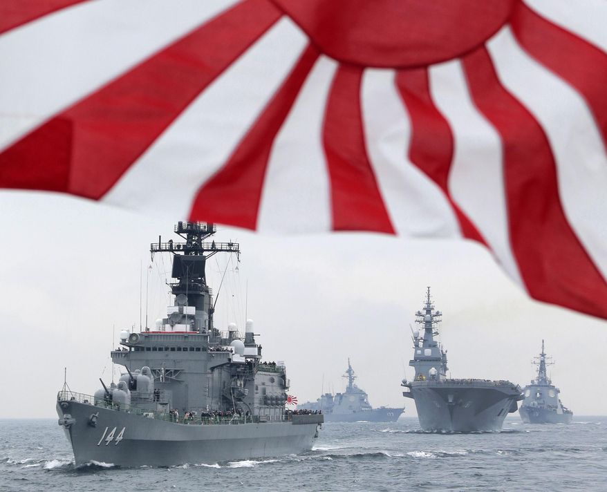 FILE - In this Oct. 14, 2012, file photo, Japan Maritime Self-Defense Force (JMSDF) escort ship Kurama leads other vessels during a fleet review in waters off Sagami, south of Tokyo. Japan's Defense Ministry wants to buy an advanced Aegis radar-equipped destroyer and more F-35 fighters under its largest-ever budget to bolster the defense of southern islands amid a territorial dispute with China. The ministry endorsed a 5.1 trillion yen ($42 billion) budget request Monday, Aug. 31, 2015 for the year beginning next April, up 2.2 percent from this year. It would be the fourth annual increase under Japanese Prime Minister Shinzo Abe, who took office in December 2012 and ended 10 years of defense budget cuts. (AP Photo/Itsuo Inouye, File)