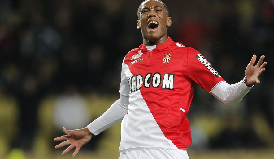 FILE - This is a Sunday, Dec. 8, 2013 file photo of Monaco's Anthony Martial of France as he reacts  during his French League One soccer match, in Monaco stadium against Ajaccio.  The French Football Federation said Monday  Aug. 31, 2015 that Martial, a 19-year-old forward who has been compared to France great Thierry Henry, was granted permission to leave France's national squad to sign a contract at Manchester United. (AP Photo/Lionel Cironneau, File)