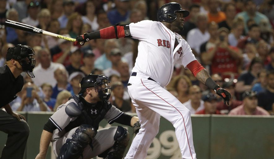 Boston Red Sox designated hitter David Ortiz, right, follows through on his swing as he hits a home run while New York Yankees catcher Brian McCann, left, looks on in the fourth inning of a baseball game, Monday, Aug. 31, 2015, at Fenway Park, in Boston. (AP Photo/Steven Senne)