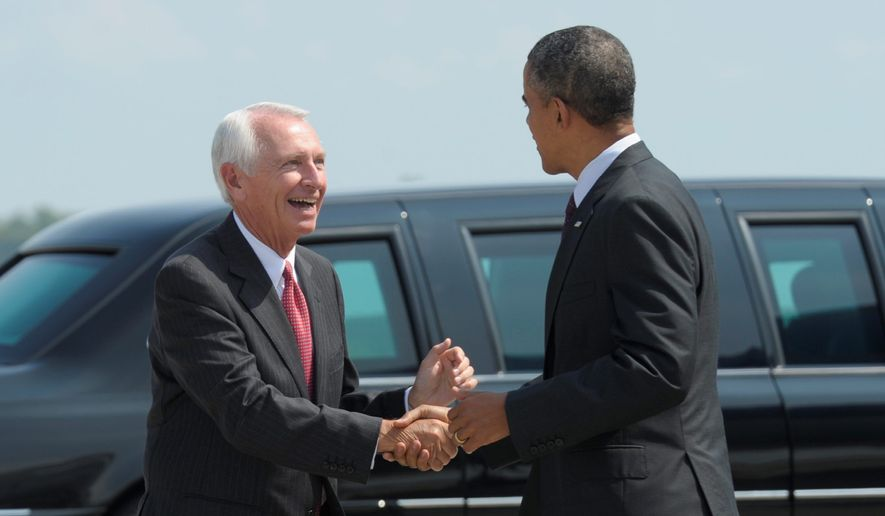 "Kentucky Gov. Steve Beshear is working with President Obama as part of a ""core group"" on climate policy. Publicy, he opposes many environmental regulations. (Associated Press)"