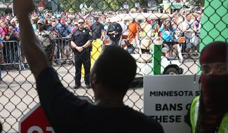 Black Lives Matter protesters agitate at the front gate of the Minnesota State Fair during a protest Saturday. Some fear the protest movement may be promoting violence against police that contributed to a Houston deputy's slaying by a black man Friday. (Star Tribune via Associated Press)