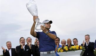 Jason Day, of Australia, holds up the winner's trophy after winning The Barclays golf tournament Sunday, Aug. 30, 2015, in Edison, N.J. (AP Photo/Mel Evans)