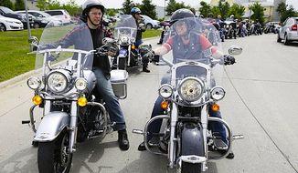 Gov. Scott Walker and Sen. Joni Ernst on a Harley-enhanced campaign ride in Iowa earlier in 2015. (AP Photo)