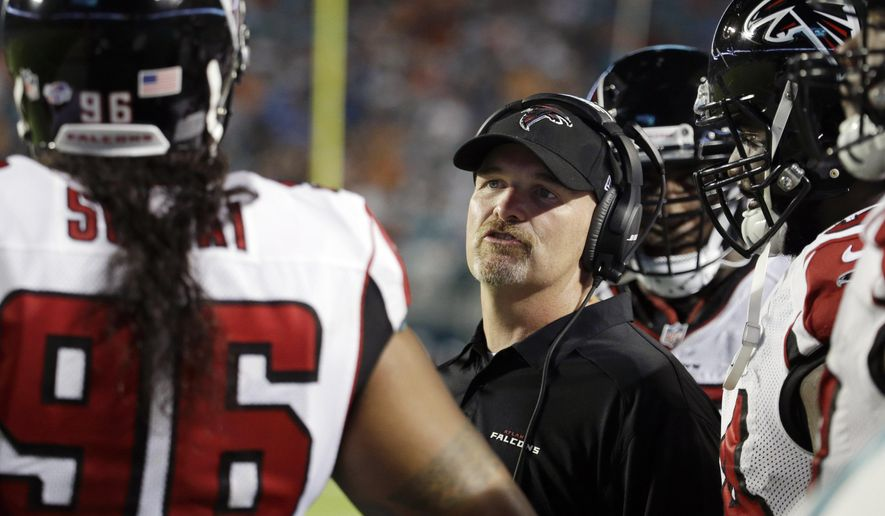 Atlanta Falcons head coach Dan Quinn speaks to Atlanta Falcons defensive tackle Paul Soliai (96) during the first half of a preseason NFL football game, Saturday, Aug. 29, 2015 in Miami Gardens, Fla. (AP Photo/Lynne Sladky)