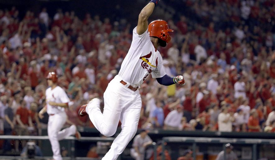 St. Louis Cardinals' Jason Heyward, right, celebrates after hitting an two-run double as Stephen Piscotty, left, comes in to score during the seventh inning of a baseball game against the Washington Nationals Monday, Aug. 31, 2015, in St. Louis. (AP Photo/Jeff Roberson)