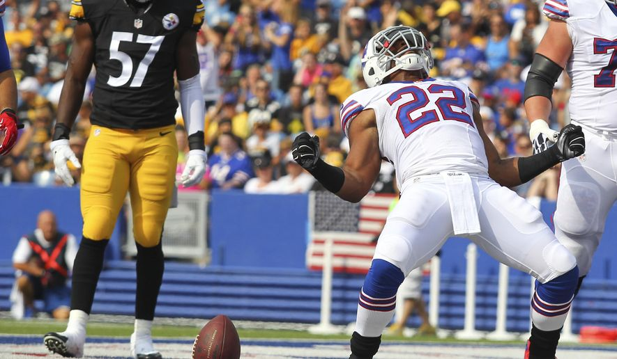 Buffalo Bills running back Fred Jackson (22) celebrates his touchdown in front of Pittsburgh Steelers inside linebacker Terence Garvin (57) during the first half of a preseason NFL football game on Saturday, Aug. 29, 2015, in Orchard Park, N.Y. (AP Photo/Bill Wippert)