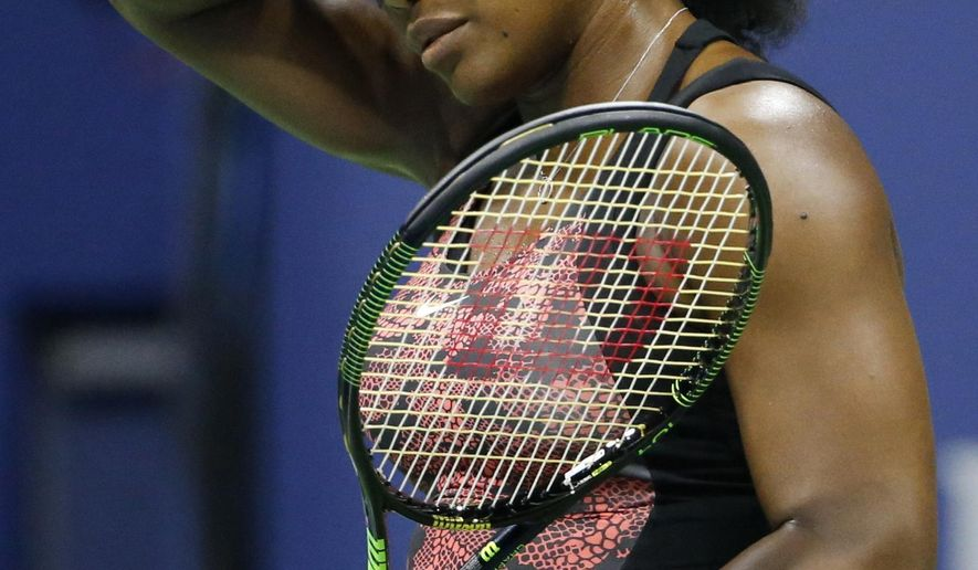 U.S. Open defending champion Serena Williams of the United States wipes her brow on a hot and humid night during her first round match against Vitalia Diatchenko of Russia in the U.S. Open Tennis  tournament in New York, Monday, Aug. 31, 2015.  (AP Photo/Kathy Willens)