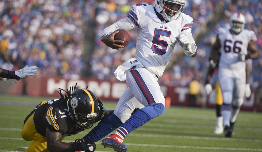 Buffalo Bills quarterback Tyrod Taylor (5) gets past Pittsburgh Steelers inside linebacker Sean Spence (51) on a touchdown run during the second half of a preseason NFL football game on Saturday, Aug. 29, 2015, in Orchard Park, N.Y. (AP Photo/Gary Wiepert)