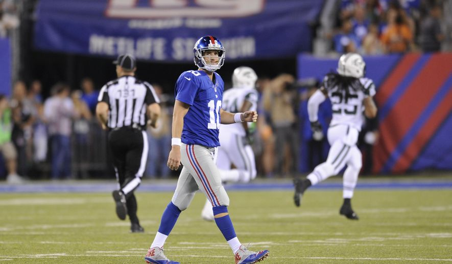 New York Giants quarterback Eli Manning (10) reacts after throwing an interception during the first half of a preseason NFL football game against the New York Jets, Saturday, Aug. 29, 2015, in East Rutherford, N.J. (AP Photo/Bill Kostroun)