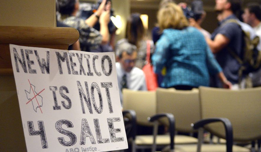 A protest sign sits after Albuquerque schools board members announced Monday, Aug. 31, 2015, in Albuquerque, N.M. that Superintendent Luis Valentino would resign following his hiring of an administrator charged with child sex abuse. Valentino had been schools chief for only two months. (AP Photo/Russell Contreras)