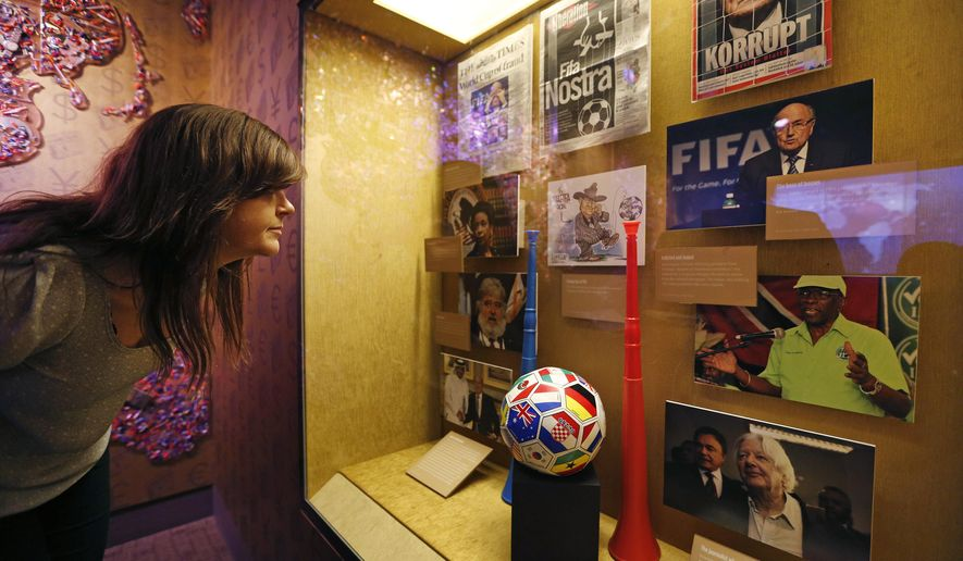 "Krissi Reeves looks at a display on FIFA at the Mob Museum Tuesday, Sept. 1, 2015, in Las Vegas. A display on FIFA corruption titled ""The 'Beautiful Game' Turns Ugly""opens at the museum Tuesday. (AP Photo/John Locher)"