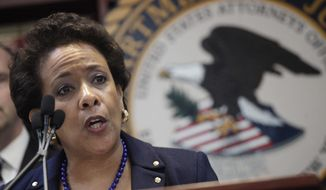 FILE - This is a Wednesday, May 27, 2015 file photo of U.S. Attorney General Loretta Lynch as she announces an indictment against nine FIFA officials and five corporate executives for racketeering, conspiracy and corruption at a news conference in the Brooklyn borough of New York. Federal prosecutors leading investigations of corruption in international football are to hold a joint news conference in FIFA's home city. On Sept. 14 in Zurich, U.S. attorney general Loretta Lynch and her counterpart from Switzerland, Michael Lauber, will give updates on their cases, Lauber's office said Tuesday Sept. 1, 2015.  (AP Photo/Mark Lennihan, File)