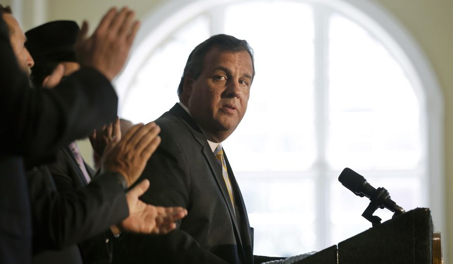 New Jersey Gov. Chris Christie listens to applause after he called on Democratic Sen. Cory Booker and the state's congressional delegation to join Sen. Bob Menendez in opposing the Iran deal, which aims to dismantle Iran's nuclear capabilities in exchange for relief from international economic sanctions worth billions of dollars, at the Chabad House at Rutgers University in New Brunswick, N.J., on Aug. 25, 2015. (Associated Press) **FILE**
