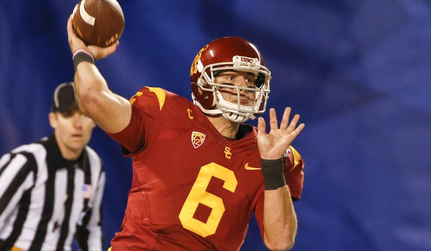 FILE - In this Dec. 27, 2014, file photo, Southern California quarterback Cody Kessler throws a pass against Nebraska during the first half of the Holiday Bowl NCAA college football game in San Diego. Kessler has already made it through almost every conceivable challenge and distraction at Southern California. (AP Photo/Lenny Ignelzi, File)