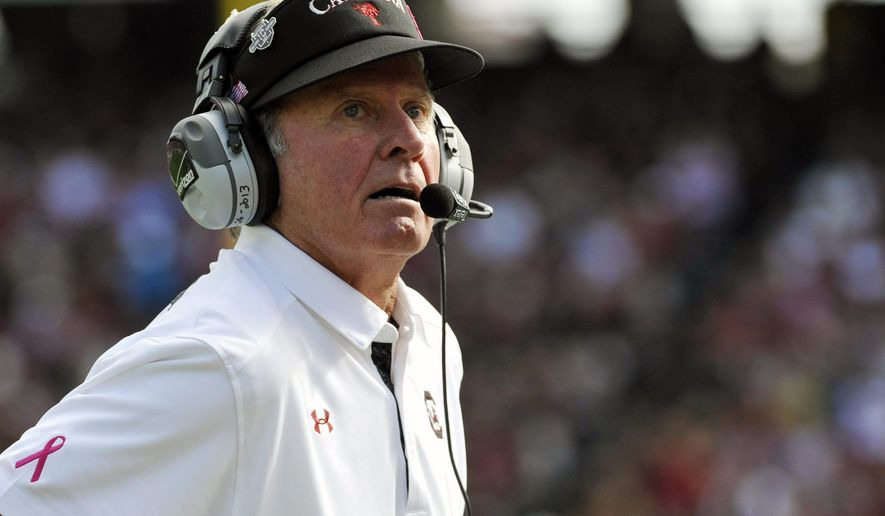 FILE - In this Nov. 2, 2013 file photo, South Carolina head coach Steve Spurrier looks on during the first half of an NCAA college football game against Mississippi State. North Carolina has overhauled its defensive coaching staff and scheme after giving up the most programs and yards in program history last year. North Carolina opens against South Carolina, Thursday, Sept. 3, 2015 and will provide the first look at whether the Tar Heels have improved at all.  (AP Photo/Rainier Ehrhardt, File)