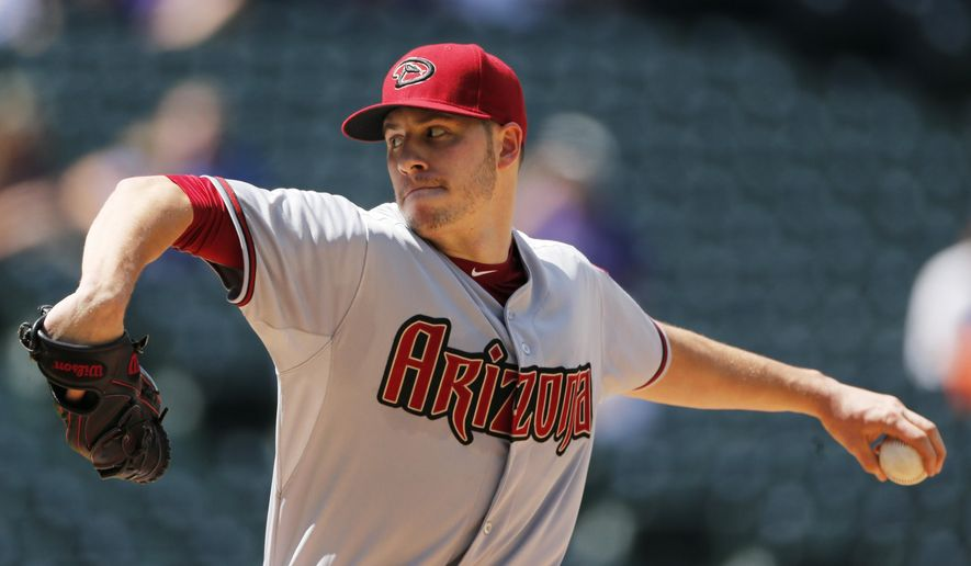 Arizona Diamondbacks starting pitcher Patrick Corbin throws against the Colorado Rockies during the second inning in the first game of a baseball doubleheader, Tuesday, Sept. 1, 2015, in Denver. (AP Photo/Jack Dempsey)