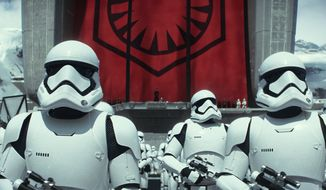 """This photo provided by Disney shows stormtroopers in a scene from the new film, """"Star Wars: The Force Awakens."""" The movie releases in the U.S. on Dec. 18, 2015. (Film Frame/Copyright Lucasfilm 2015 via AP)"""