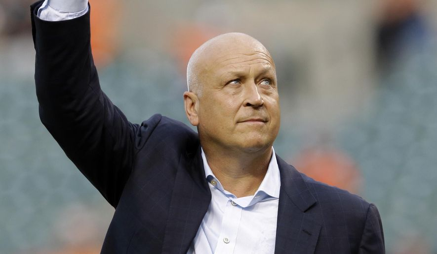 Former Baltimore Oriole Cal Ripken, Jr., acknowledges fans before throwing out the ceremonial first pitch to mark the twentieth anniversary of his streak of 2,131 straight games before a baseball game between the Orioles and the Tampa Bay Rays, Tuesday, Sept. 1, 2015, in Baltimore. (AP Photo/Patrick Semansky)