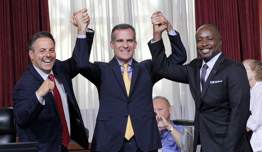 Councilman Joe Buscaino, left, with Los Angeles Mayor Eric Garcetti, center, and Councilman Marqueece Harris-Dawson celebrate after a city council vote in Los Angeles on Tuesday, Sept. 1, 2015. The Los Angeles City Council cleared the way Tuesday for Garcetti to strike agreements for a 2024 Olympics bid, putting the city on the verge of becoming the U.S. contender after Boston's awkward collapse. (AP Photo/Nick Ut) **FILE**