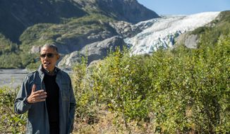President Obama speaks to members of the media while on a hike to the Exit Glacier in Seward, Alaska, on Sept. 1, 2015, which according to National Park Service research, has retreated approximately 1.25 miles over the past 200 years. Obama is on a historic three-day trip to Alaska aimed at showing solidarity with a state often overlooked by Washington, while using its glorious but changing landscape as an urgent call to action on climate change. (Associated Press) **FILE**