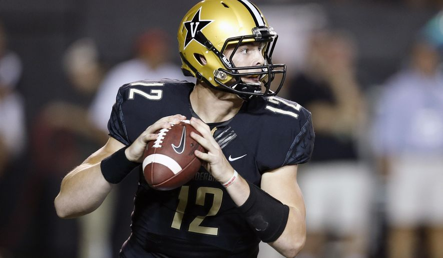 FILE - In this Sept. 20, 2014, file photo, Vanderbilt quarterback Wade Freebeck passes against South Carolina during the second quarter of an NCAA college football game in Nashville, Tenn. The Commodores are keeping their starting quarterback a secret until the first series of their opener Thursday night, Sept. 3, 2015, against Western Kentucky.(AP Photo/Mark Humphrey, File)