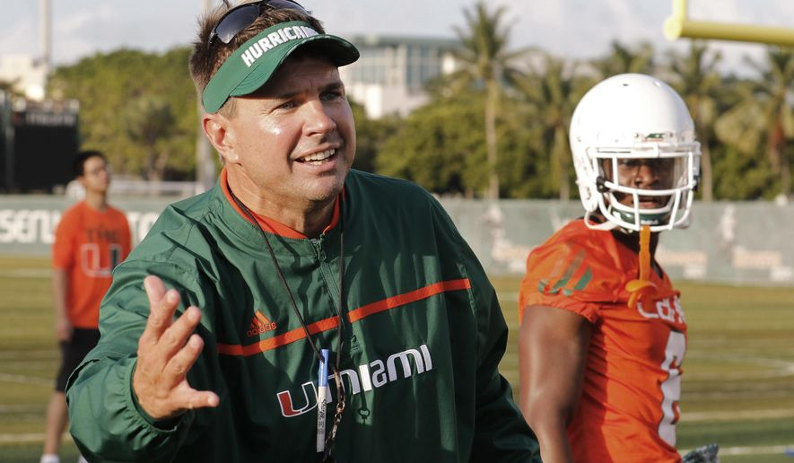 "FILE - In this Friday, Aug. 7, 2015 file photo, Miami head coach Al Golden works with his players during an NCAA college football practice in Coral Gables, Fla. The team is not bothered by a national perception that they will struggle this season. Losing Gus Edwards late last month to a season-ending foot injury means there's many more carries up for grabs in a relatively untested Miami backfield. ""We don't feel like we're going to miss a beat there,"" Miami coach Al Golden said Tuesday. ""We feel badly for Gus, disappointed for him. He worked really hard but he's coming back, he's in great spirits and it's a great opportunity for the other three guys to step up and execute."" (AP Photo/Joe Skipper, File)"