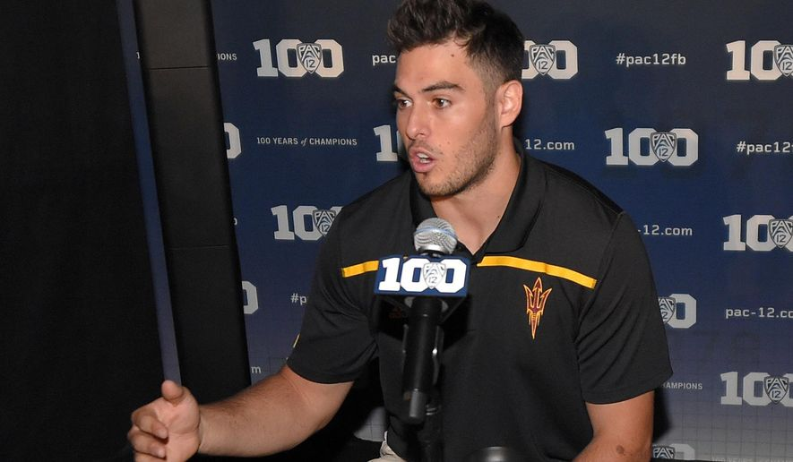 FILE - In this July 30, 2015, file photo, Arizona State quarterback Mike Bercovici speaks to reporters during Pac-12 Football Media Days in Burbank, Calif. Facing at least two seasons as a back-up, Bercovici could have easily transferrered without anyone blaming him. Instead, he decided to stick it out at Arizona State and is a big reason the 15th-ranked Sun Devils are being mentioned as a possible College Football Playoff team. (AP Photo/Mark J. Terrill, File)