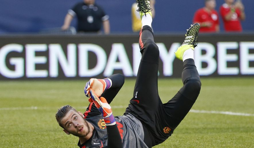 FILE - This is a Wednesday, July 29, 2015 file photo of  Manchester United's  goalkeeper David de Gea as he warms up before an International Champions Cup soccer match against Paris Saint-Germain in Chicago.  In a surreal ending to the  Monday Aug. 31, 2015 transfer window in Spain, the much-anticipated move of Manchester United goalkeeper David de Gea to Real Madrid never materialized. The clubs reportedly struck a deal, but the expected announcement never came, apparently because the paperwork wasn't submitted on time.  (AP Photo/Kamil Krzaczynski, File)