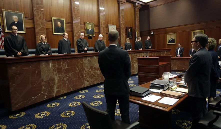 """Texas supreme court judges arrive in the chamber for Texas' latest school finance trial, Tuesday, Sept. 1, 2015, in Austin, Texas. Attorneys for more than 600 school districts suing Texas argue that the funding is inadequate and unfairly distributed, making it hard for students and schools to meet stringent academic standards. Attorney General Ken Paxton's office counters that, while not perfect, public education money meets state constitutional requirements for an efficient system providing a """"general diffusion of knowledge.""""(AP Photo/Eric Gay, Pool)"""