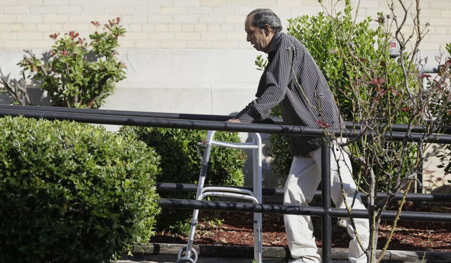 Sureshbhai Patel steadies himself with a walker as he arrives at the federal courthouse before start of a trial against Madison, Ala., police officer Eric Sloan Parker, Tuesday, Sept. 1, 2015, in Huntsville, Ala. Patel, who was visiting relatives from his native India in February, was walking in his son's neighborhood when police responding to a call about a suspicious person stopped to question him. A police video captured an officer slamming the man to the ground, partially paralyzing him. (AP Photo/Brynn Anderson)