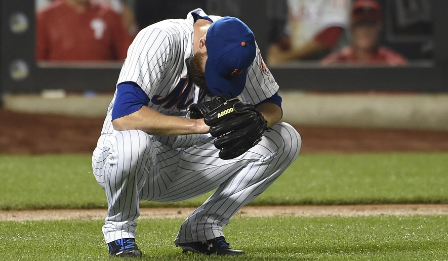 New York Mets relief pitcher Bobby Parnell reacts as Philadelphia Phillies' Andres Blanco scores on his throwing error during the sixth inning of a baseball game Tuesday, Sept. 1, 2015, in New York. (AP Photo/Kathy Kmonicek)