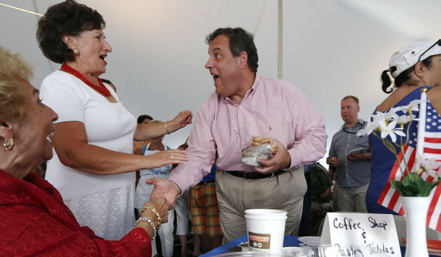 Republican presidential candidate, New Jersey Gov. Chris Christie, center, greets people during a campaign stop at a Greek festival in Manchester, N.H., Saturday, Aug. 29, 2015. (AP Photo/Michael Dwyer)
