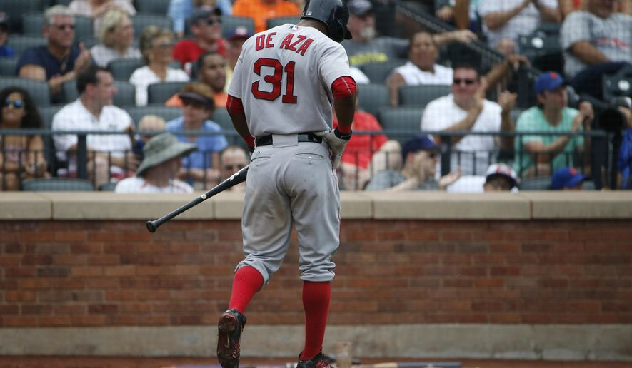 Boston Red Sox's Alejandro De Aza (31) walks to the dugout after striking out, stranding two runners on base, in the ninth inning of a baseball game against the New York Mets, Sunday, Aug. 30, 2015, in New York. The Mets won 5-4. (AP Photo/Kathy Willens)
