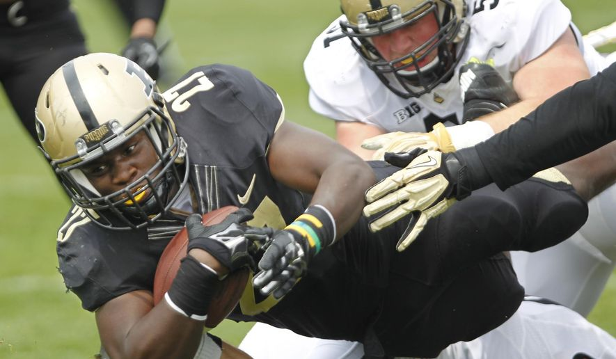 FILE - In this April 18, 2015, file photo, Purdue's D.J. Knox dives for a touchdown for the Black team in the Gold & Black spring NCAA college football game in West Lafayette, Ind. Knox and Markell Jones will get a chance to show what they can do in their first significant college action Saturday at Marshall. (John Terhune/Journal & Courier via AP, File) MANDATORY CREDIT; NO SALES  /Journal & Courier via AP, File) MANDATORY CREDIT; NO SALES; LOCAL TV OUT; LOCAL RADIO OUT; LOCAL INTERNET OUT