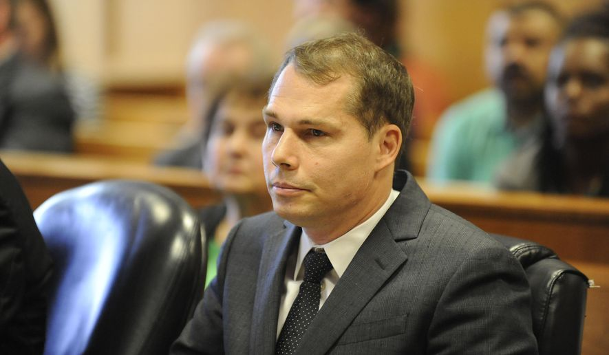 Fraffiti artist Shepard Fairey appears in Frank Murphy Hall of Justice during a preliminary examination, Tuesday Sept. 1, 2015, in Detroit. Fairey is charged with malicious destruction of property for allegedly tagging buildings in Detroit. An attorney for the city has said three of nine properties that were damaged are city-owned. The damage has been estimated at around $30,000. (David Coates/Detroit News via AP)  DETROIT FREE PRESS OUT; HUFFINGTON POST OUT; MANDATORY CREDIT