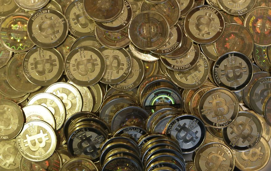 This April 3, 2013, file photo shows bitcoin tokens in Sandy, Utah. (Associated Press/File)