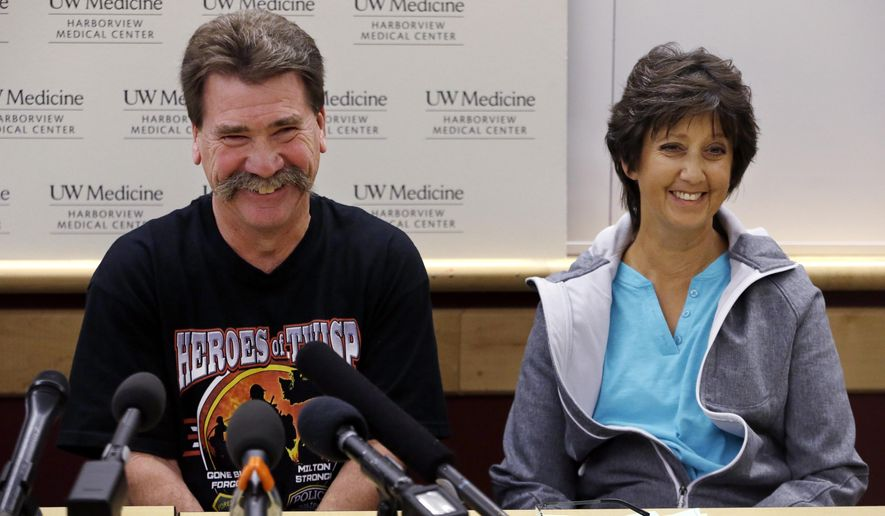 Daniel and Barbara Lyon, parents of injured firefighter Daniel Lyon, smile during a brief light-hearted moment as they speak with members of the media at a news conference about their son's recovery Tuesday, Sept. 1, 2015, at Harborview Medical Center in Seattle. The younger Daniel Lyon, who was injured in a wildfire Aug. 19 near Twisp, Wash., that killed three firefighters, has undergone multiple surgeries and more are planned. (AP Photo/Elaine Thompson)