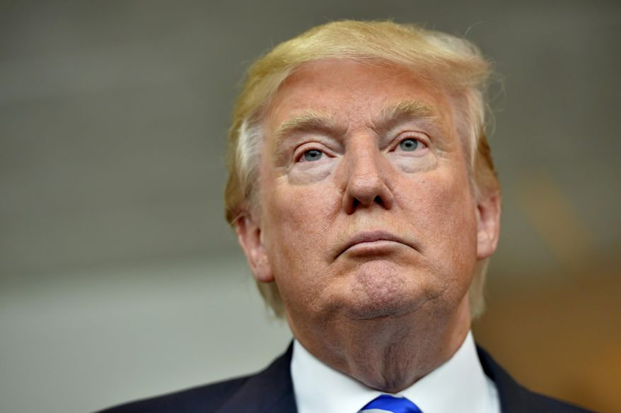 Republican presidential candidate Donald Trump listens during a news conference after speaking at the TD Convention Center, in Greenville, S.C. (Associated Press) **FILE**
