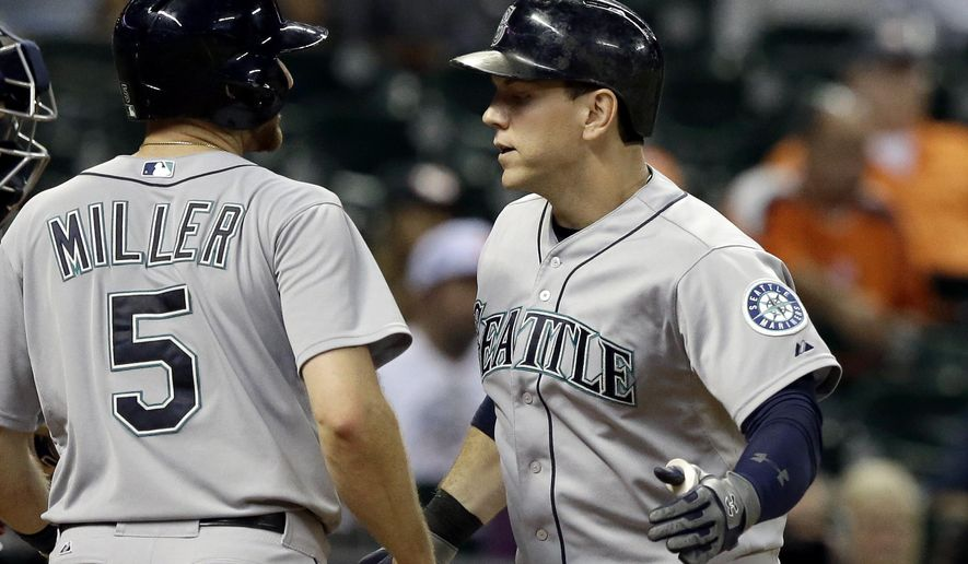 Seattle Mariners' Logan Morrison, right, is welcomed home by Brad Miller (5) after hitting a two-run home run against the Houston Astros during the eighth inning of a baseball game Tuesday, Sept. 1, 2015, in Houston. (AP Photo/Pat Sullivan)