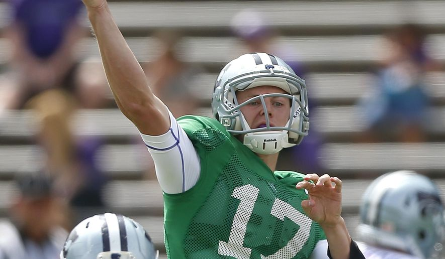 FILE - In this April 26, 2014, file photo, Kansas State quarterback Jesse Ertz throws downfield during the second half of an NCAA college spring football game in Manhattan, Kan. Ertz has won a four-way competition to start at quarterback Saturday in the season opener against South Dakota. Ertz beat out junior Joe Hubener and freshman Alex Delton, who were listed as co-backups on the depth chart released Tuesday. Junior college transfer Jonathan Banks was also in the mix but chose to redshirt rather than sit deeper on the chart. (AP Photo/Topeka Capital-Journal, Chris Neal, File)